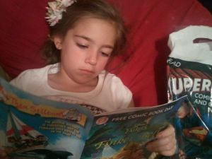 Addie reading comic